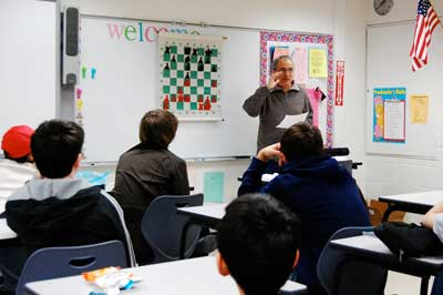 GM Dmitry Gurevich gives a lesson to ICA Warren Junior Scholars